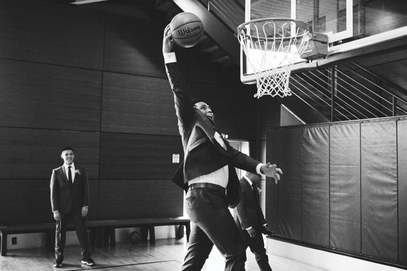 Groom playing basketball